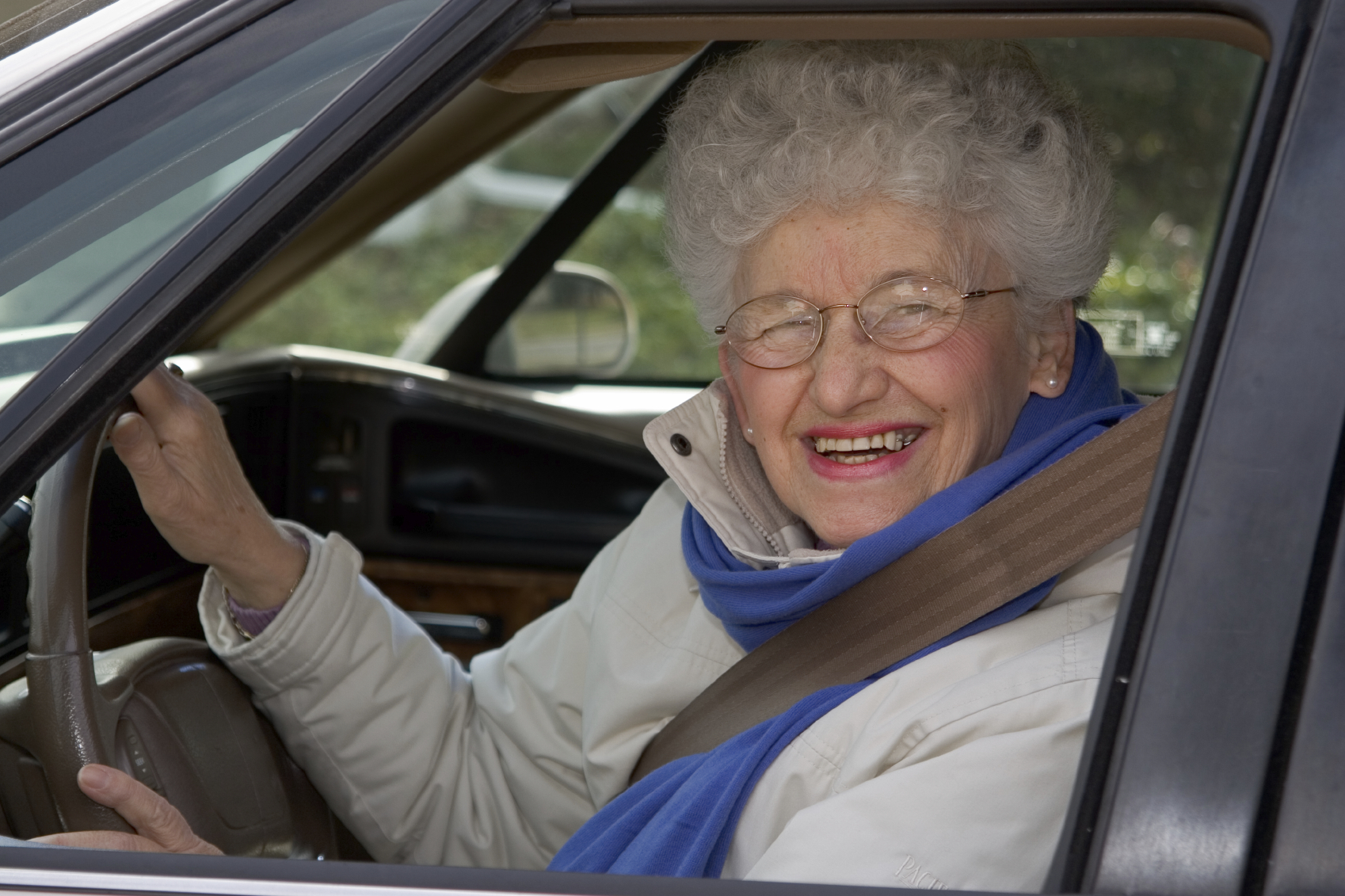A senior woman at the wheel of her car. Reference image 2559 taken February 10, 2006 by John Archer.